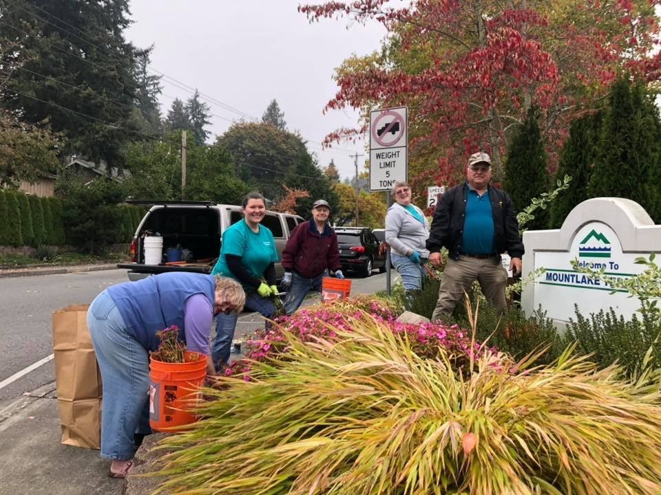 Garden Club Volunteers by sign at 48th & 244th