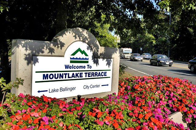 Mountlake Terrace Welcome Sign surrounded by a flower bush